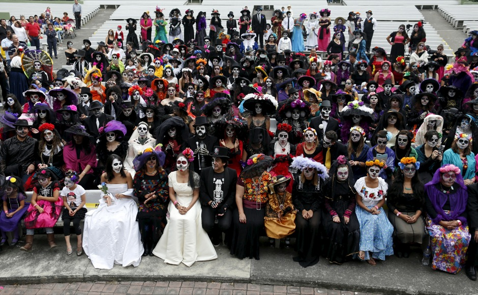 "People with their faces painted to look like the popular Mexican figure called ""Catrina"" take part in the annual Catrina Fest in Mexico City"